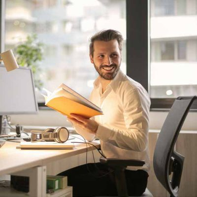 Portrait of business executive using digital tablet in office